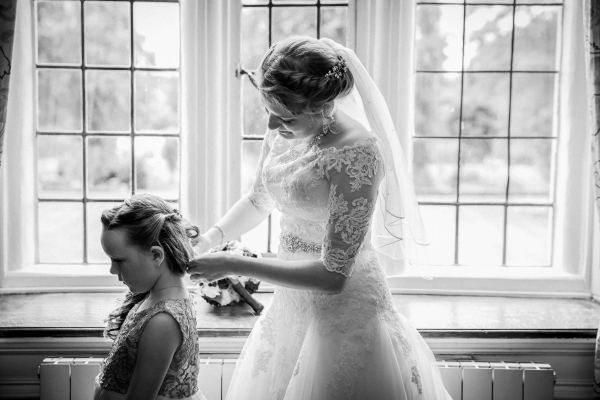 bride and little girl by window